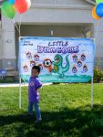 Jack in front of the Little Dragons banner