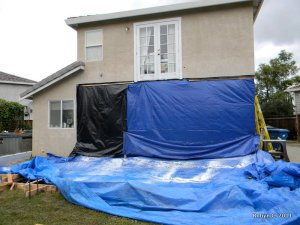 More tarps on the back of the house