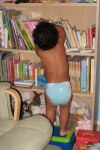 Jackson grabbing a book from the bookshelf