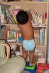 Jackson grabbing a book from the bookshelf