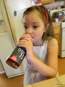 Girl drinking bottle labeled Type B