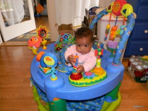 Cassie in her Exersaucer