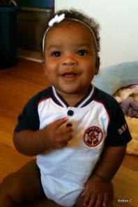 Cassie in her Boston Red Sox onesie