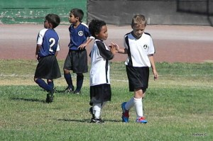 Jackson and a Teammate High Five at a Soccer Game