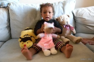 Cassie with her bee, bear, and Selena doll