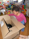Cassie opens the box for Sassy