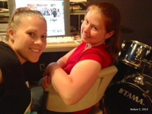 K and Robyn working at a computer
