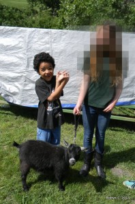 Jackson, a friend, and a pygmy goat at the 4H Showmanship Clinic