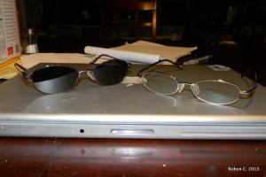 Purple sunglasses and silver eyeglasses