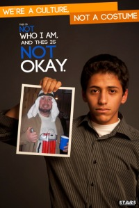 Arab boy holding a photo of a man dressed as a suicide bomber