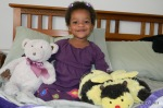 Cassie with her bear and bee