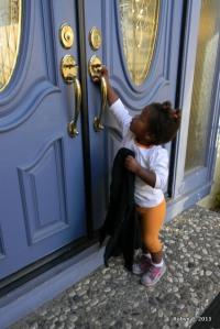 Cassie Reaching for the preschool door