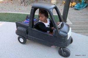 Cassie driving a Little Tykes pick up truck