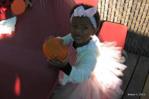 Cassie, dressed as Lambie, with a pumpkin