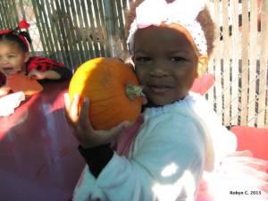 Cassie hugging a pumpkin