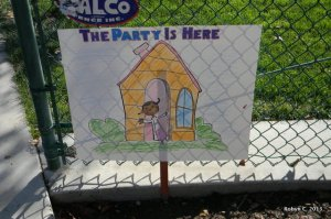 The Party Is Here Sign