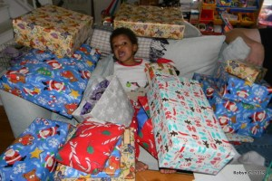 Cassie surrounded by presents