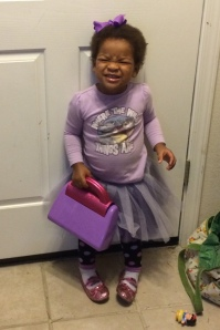 Cassie smiling, wearing lots of purple