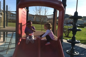 Cassie and Zoey on the slides