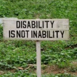 "Sign reading, ""Disability is not inability."""