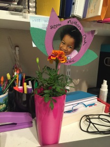 Cassie's picture in the shape of a flower, with a potted marigold